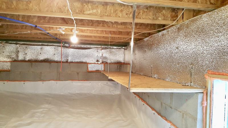 crawlspace shelves organized crawlspace well lit