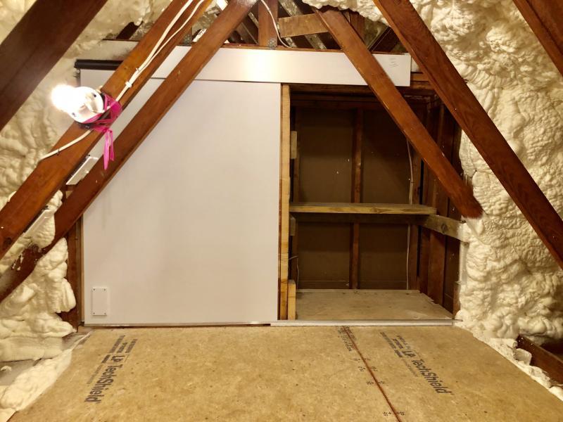 split level attic storage with sliding door