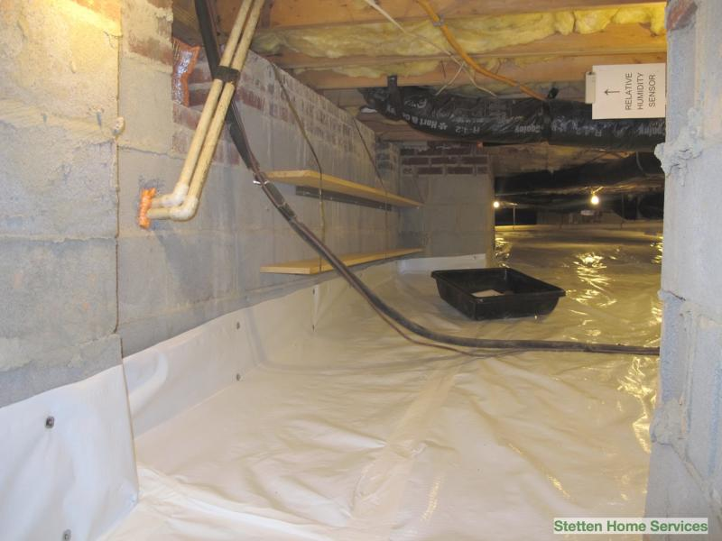 sealed crawlspace with added shelving.  Crawlspace shelves