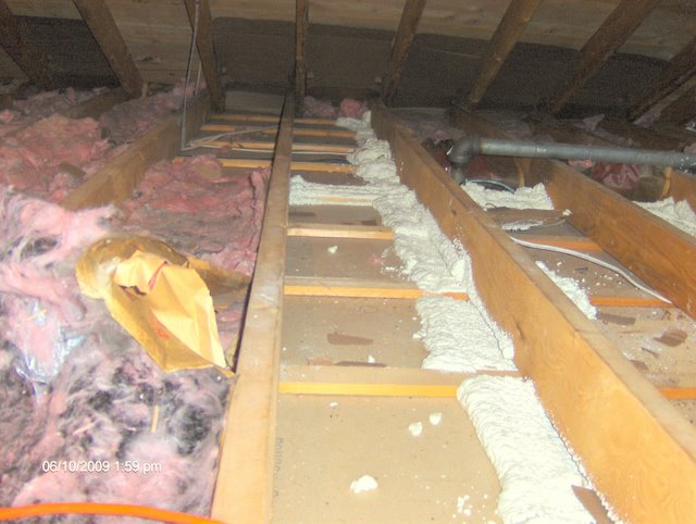air-sealing_an_interior_wall_top_from_the_attic